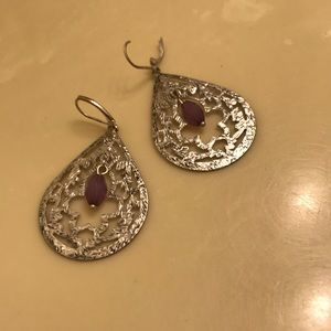 Silver earrings with purple accent.